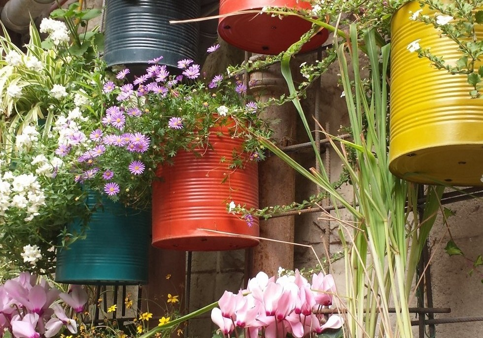 COLOURED OIL CANS WITH SPRING FLOWERS
